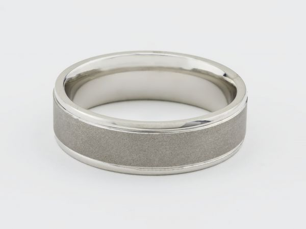 14kt 7mm White Gold Gents Wedding Band With a Stain Center and High Polished Sides
