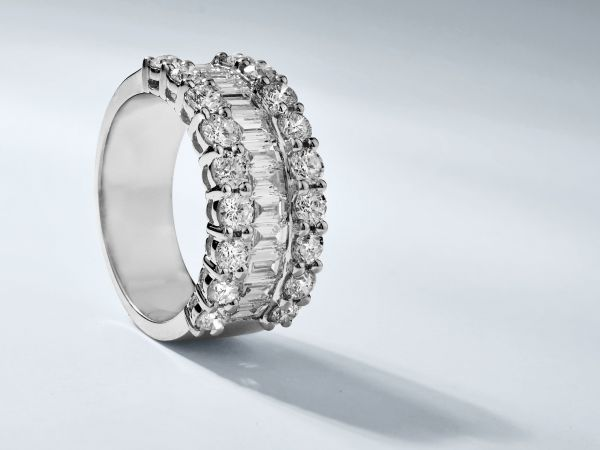 18kt White Gold Baguette And Round Diamond Right Hand Ring.