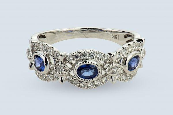 18kt White Gold Round Diamond and Blue Oval Sapphire Band