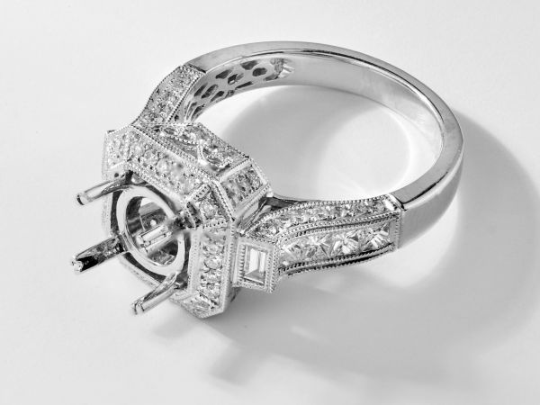 14kt White Gold Cut Corner Halo Engagement Ring With Round, Princess Cut, And Bagguette Diamonds