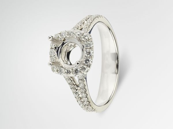 18kt White Gold Cushion Shape Halo With A Two Row Split Shank